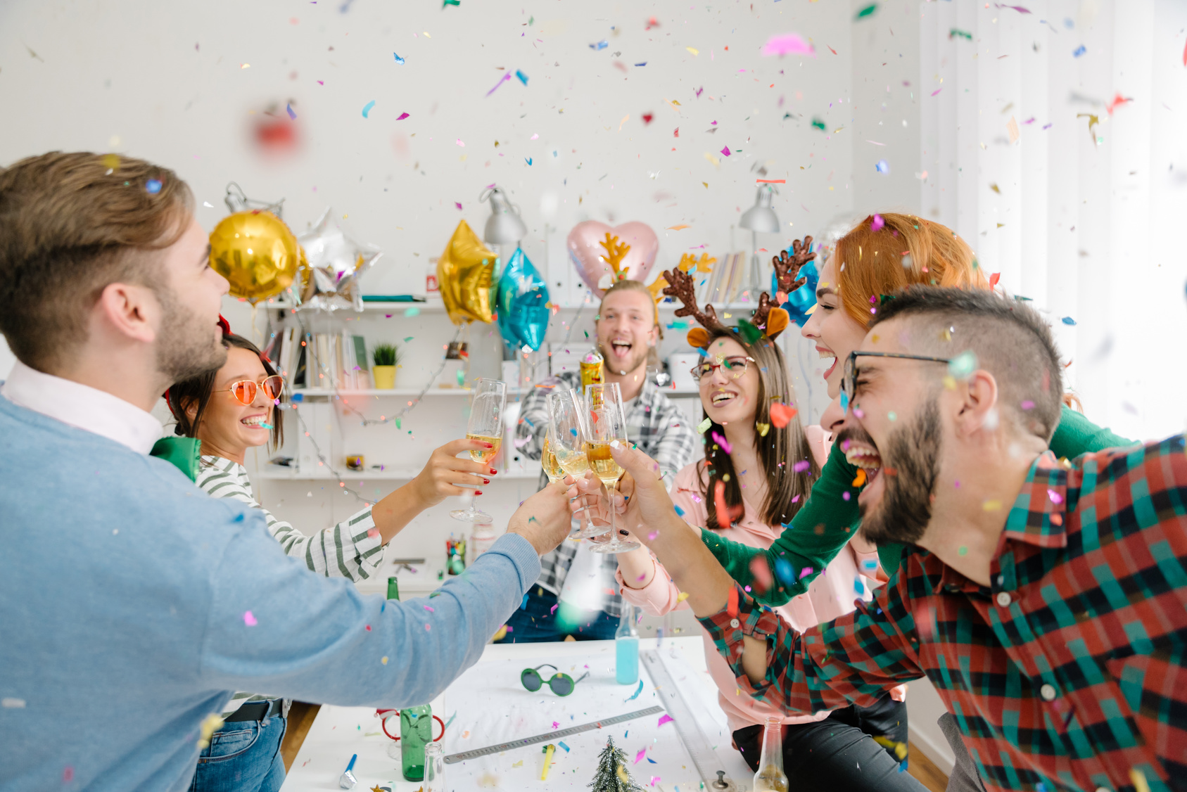 Workplace holiday party with confetti and champagne toast
