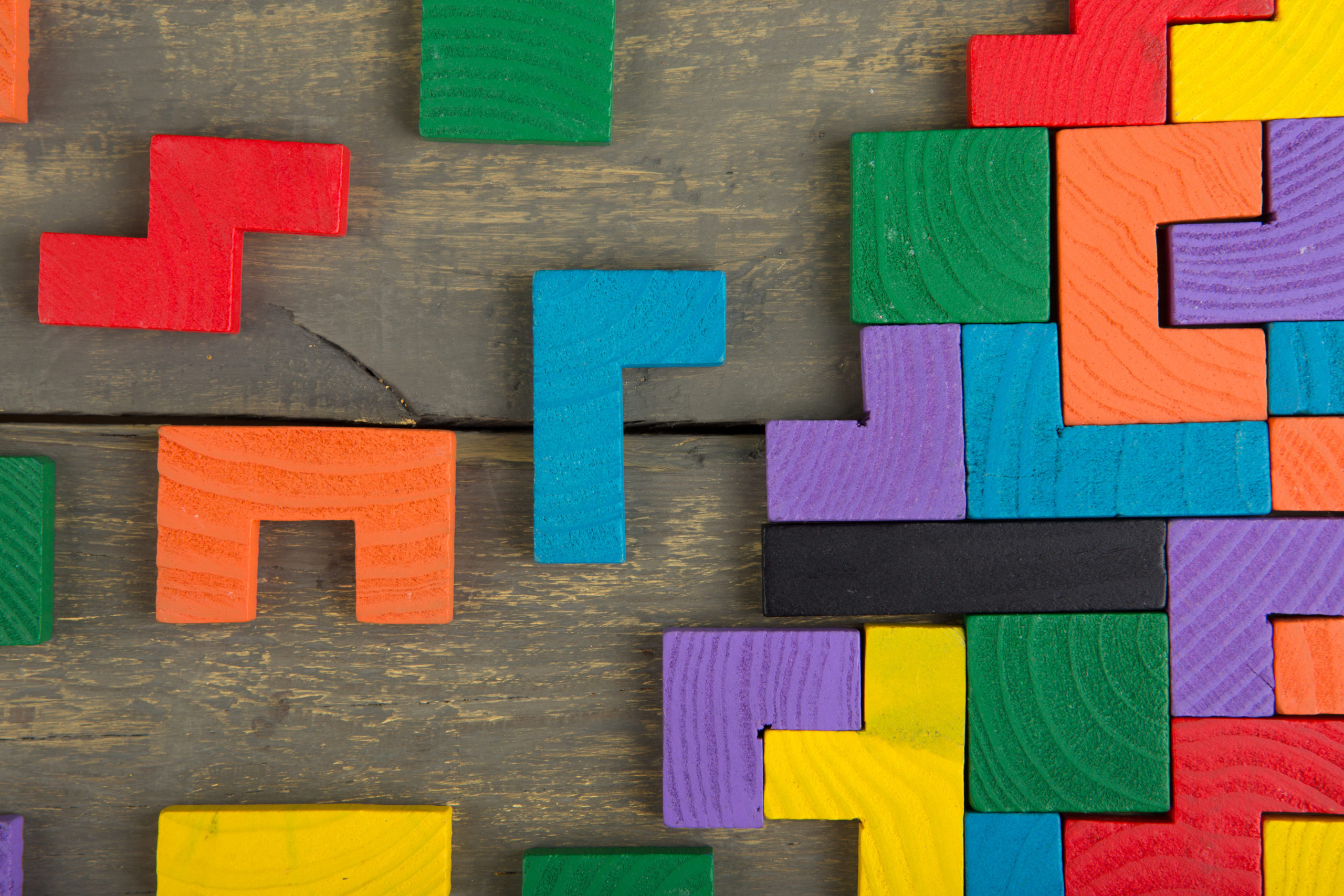 Colorful Tetris blocks on a wooden background